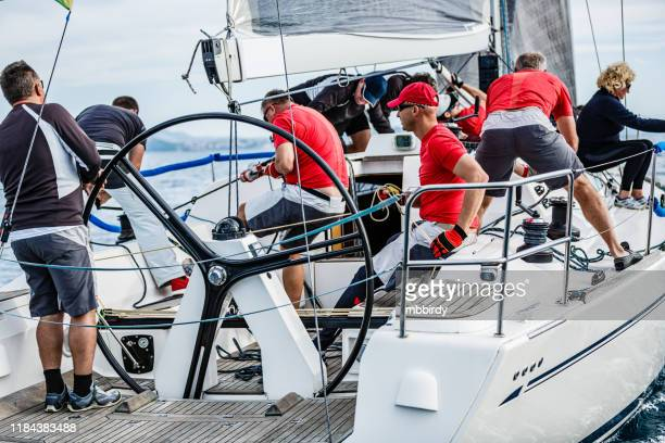 sailing crew on sailboat on regatta - sports team event stock pictures, royalty-free photos & images