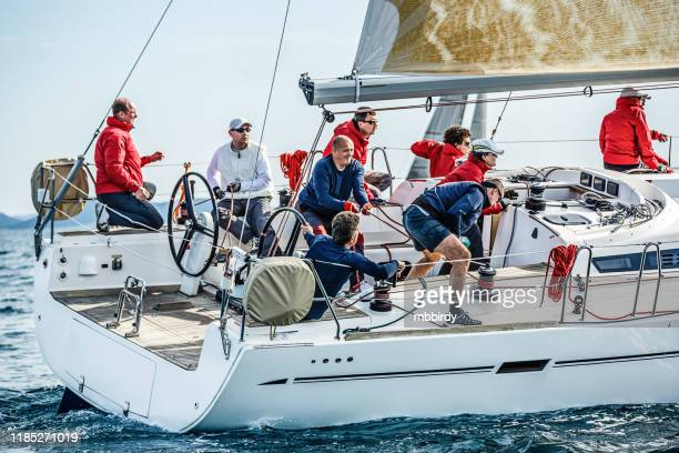 sailing crew on sailboat on regatta - sailing team stock pictures, royalty-free photos & images