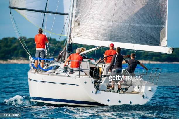 sailing crew on sailboat on regatta - yachting stock pictures, royalty-free photos & images