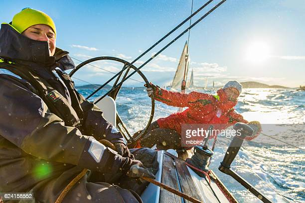 Sailing crew on sailboat on regatta