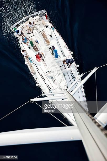 Sailing crew on sailboat