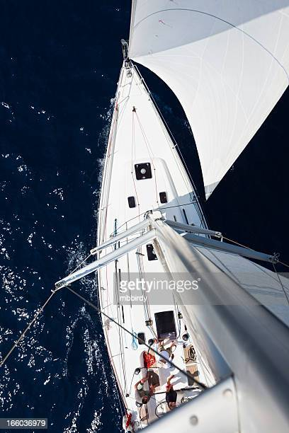 Sailing crew on sailboat