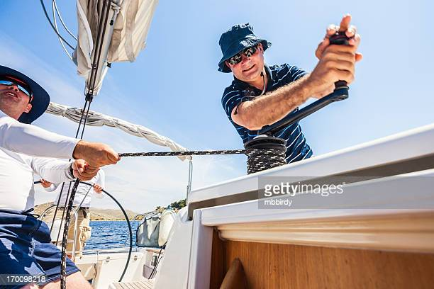 sailing crew on sailboat - sailing team stock pictures, royalty-free photos & images