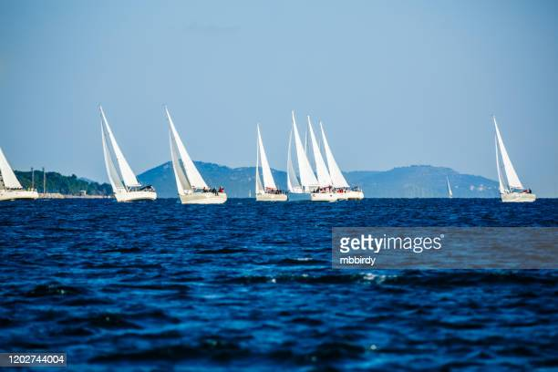 sailing crews on sailboats on regatta - sail boom stock pictures, royalty-free photos & images