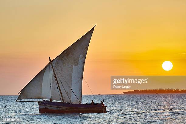 Sailing Dhow boat at sunset at Stone Town