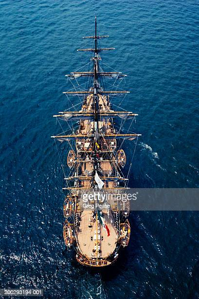 Sailing frigate with sails reefed, aerial view