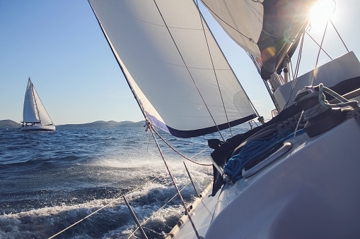 Sailing in the wind through the waves, yachts at sailing regatta 1006058700