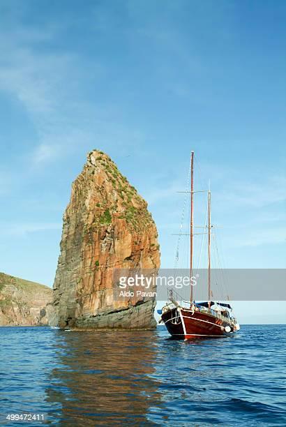 Sailing near Cala Junco, Panarea, rock