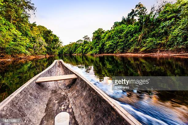 Sailing on Indigenous wooden canoe in the Amazon state Venezuela