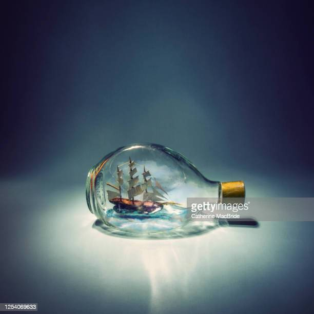 sailing on small seas - ship in a bottle stock pictures, royalty-free photos & images