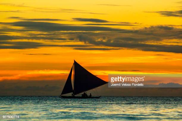 A sailing paraw/double outrigger at sunset (Boracay Island, Malay, Aklan, Philippines)