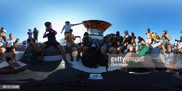 Sailing photographers wait for competition to start as light wind delays the start of the Women's 470 class race on Day 12 of the Rio 2016 Olympic...