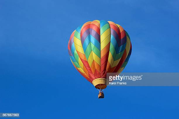 sailing rainbow colored hot air balloon
