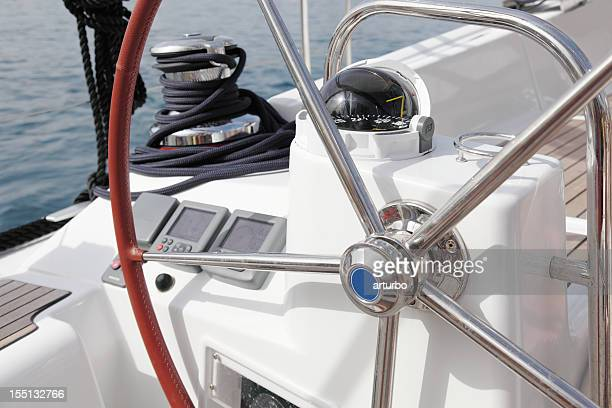 sailing ship cockpit and steering wheel