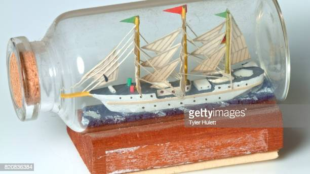 sailing ship in a bottle on white - ship in a bottle stock pictures, royalty-free photos & images