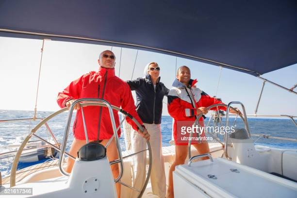 sailing skipper at the wheel of a yacht - yachting stock pictures, royalty-free photos & images