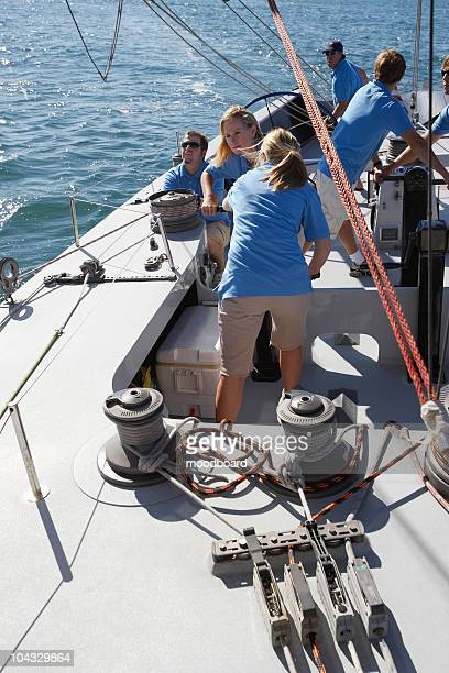 Sailing team on yacht