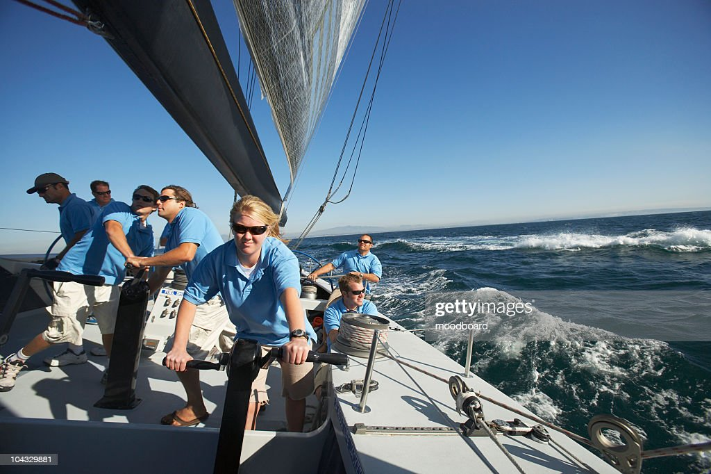 Sailing team on yacht : Stock Photo