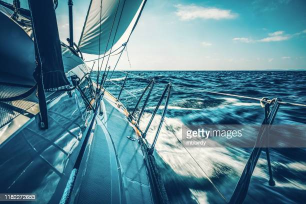 sailing with sailboat at sunset - sailor stock pictures, royalty-free photos & images