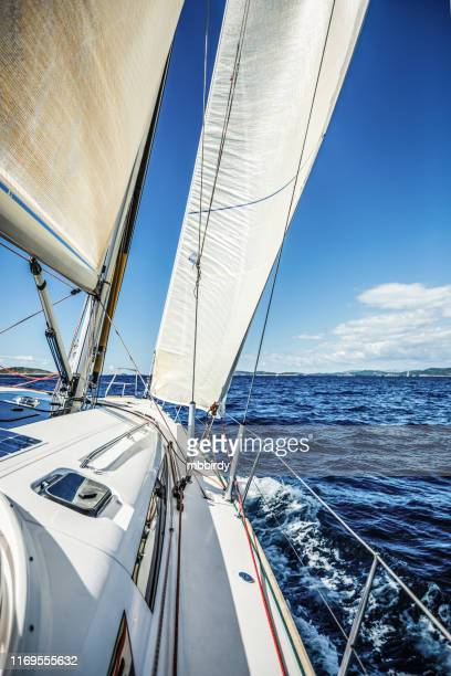 sailing with sailboat - sail boom stock pictures, royalty-free photos & images