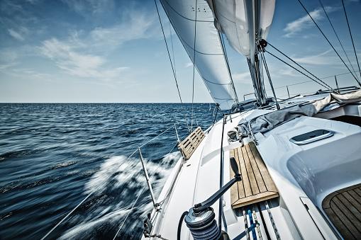 Sailing with sailboat 480615130