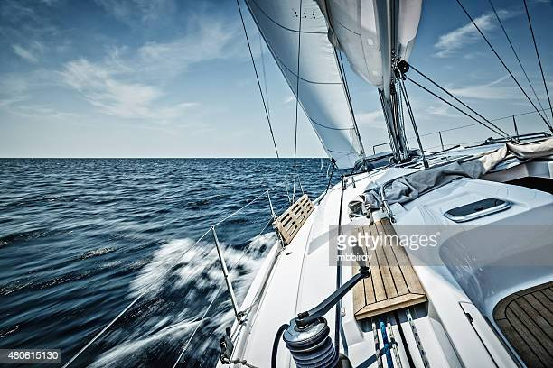 sailing with sailboat - watervaartuig stockfoto's en -beelden