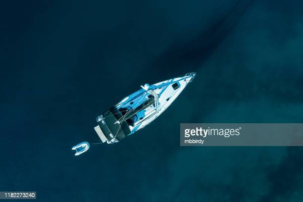 sailing with sailboat, view from drone - lifeboat stock pictures, royalty-free photos & images