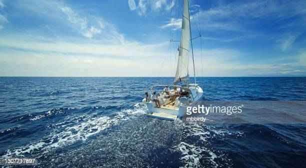 sailing with sailboat, view from drone - organised group stock pictures, royalty-free photos & images