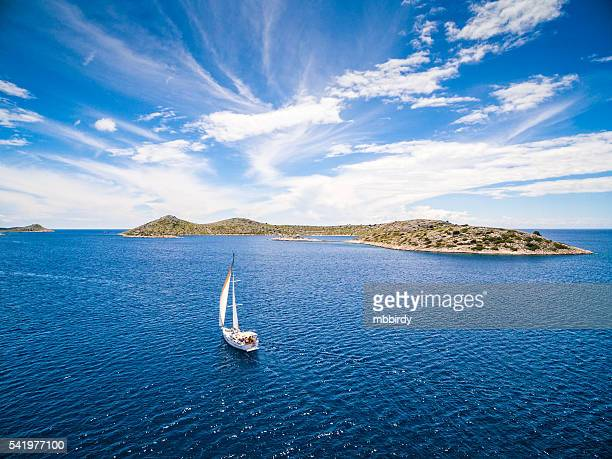 sailing with sailboat, view from drone - sailing stock pictures, royalty-free photos & images