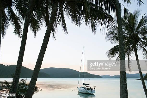 Sailing yacht anchored in bay.