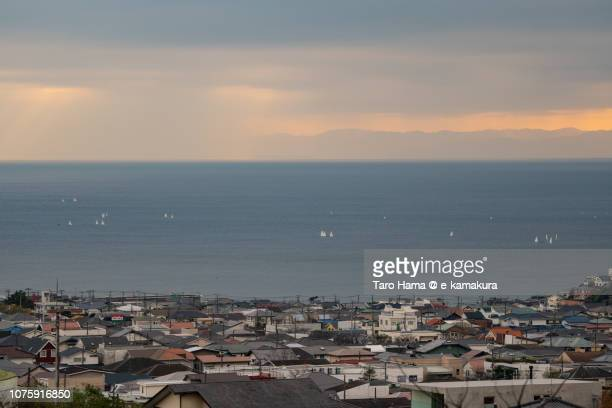 Sailing yacht and residential town by the sea in Kamakura city in Kanagawa prefecture in Japan