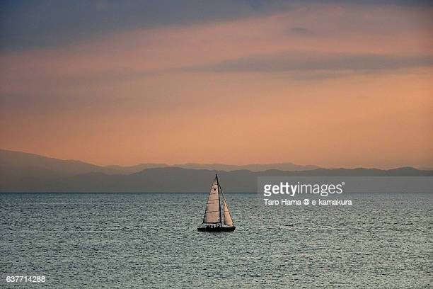 A sailing yacht in the sunset beach