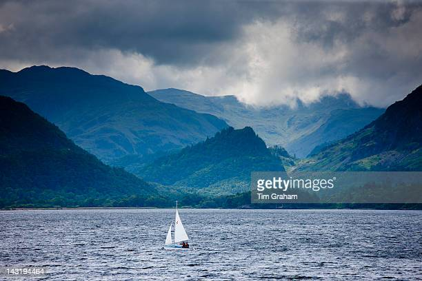 Sailing yacht on Derwent Water at Friar's Crag near Keswick in the Lake District National Park Cumbria UK