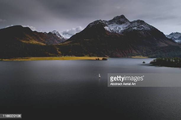 sailing yacht on lake sils, switzerland - desaturated stock pictures, royalty-free photos & images