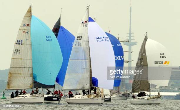 Sailing yachts start for the first regatta from Kiel to Eckernfoerde in the Fjord of Kiel Germany 22 June 2013 More than 3 million visitors and...