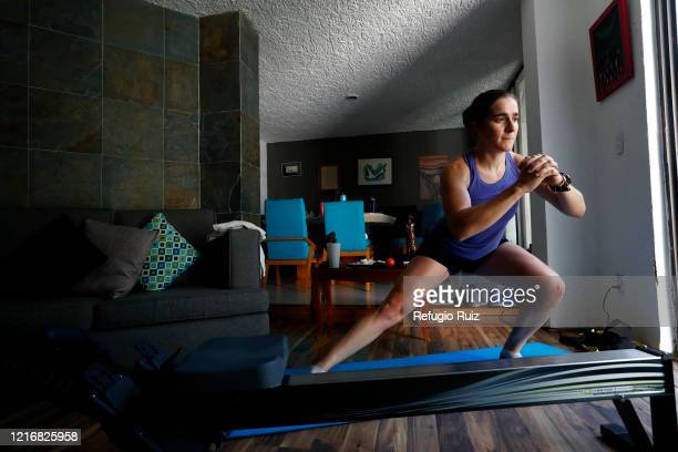 Sailor and Olympic athlete Elena Ortling does warmup exercises during a training session at home on June 1 2020 in Guadalajara Mexico Mexico remains...