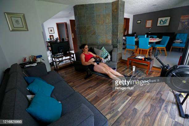 Sailor and Olympic athlete Elena Ortlingexercises on a rowing machine during a training session at home on June 1 2020 in Guadalajara Mexico Mexico...