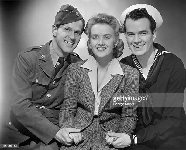 sailor and soldier holding nurse's hand - uniform stock-fotos und bilder