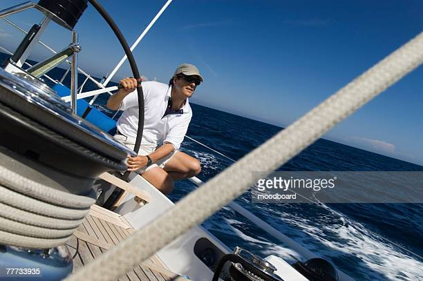 sailor at the helm during sailing yacht race - straw boater hat stock pictures, royalty-free photos & images
