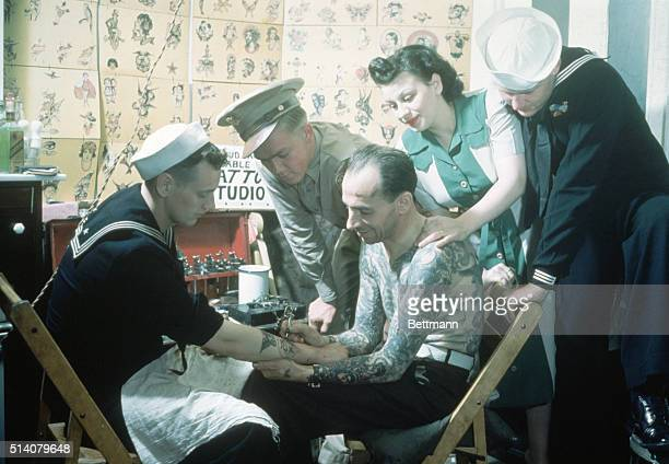Sailor being tattooed WWII era UPI color slide