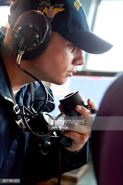Sailor communicating navigation updates aboard the USS Carl Vinson