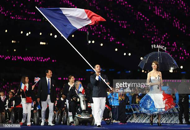 Sailor Damien Seguin of France carries the flag during the Opening Ceremony of the London 2012 Paralympics at the Olympic Stadium on August 29, 2012...