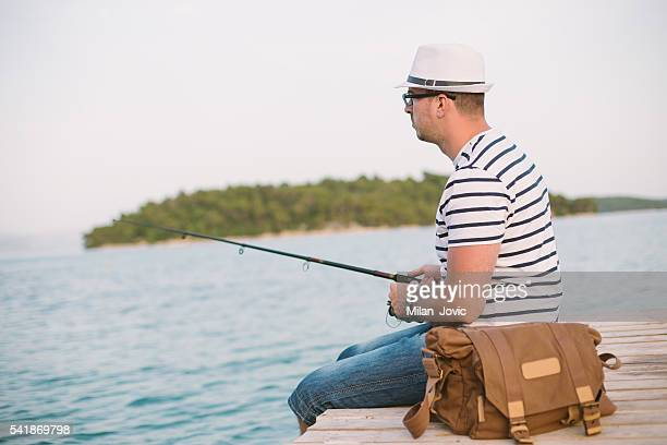 Sailor fishing on a dock