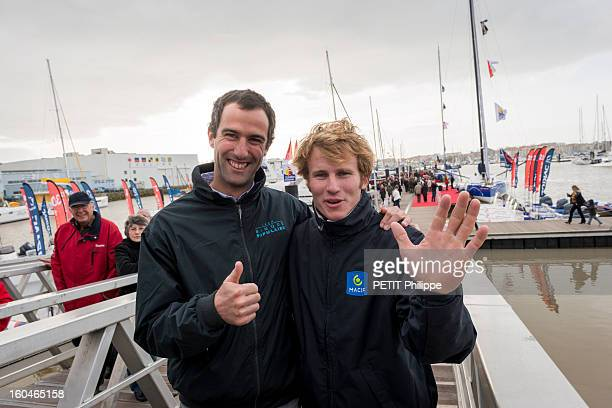 Sailor Francois Gabart with Armel Le Cleac'h (2nd place) after arriving in port after winning the Vendee Globe 2013 record with his boat Macif on January 27, 2013 in Sables d'Olonne,France. He won the Vendee Globe 2013, smashing the record round the world solo in 78 days 2 hours and 16 minutes.