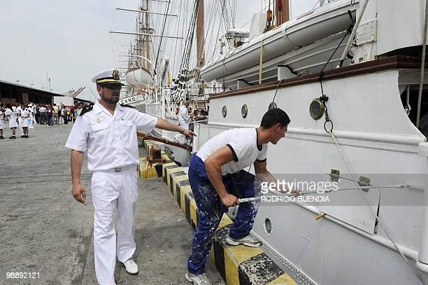 A sailor from Spain's sailboat Juan Sebastian de Elcano paint the ship upon arrival at the port of Guayaquil Ecuador during the Bicentennial Race on...