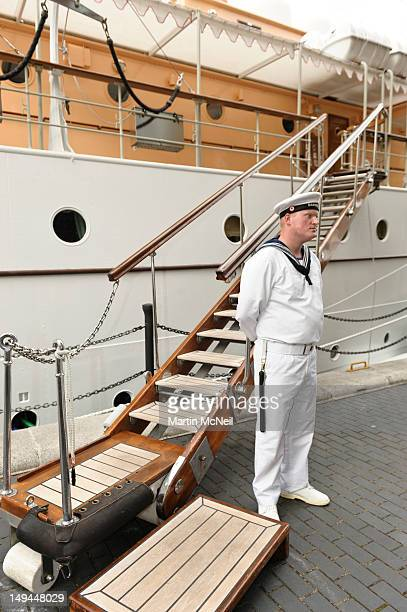 A sailor from the Danish Royal Yacht Dannenbrog stands guard ahead of a reception for businesses on the at Canary Wharf on July 28 2012 in London...