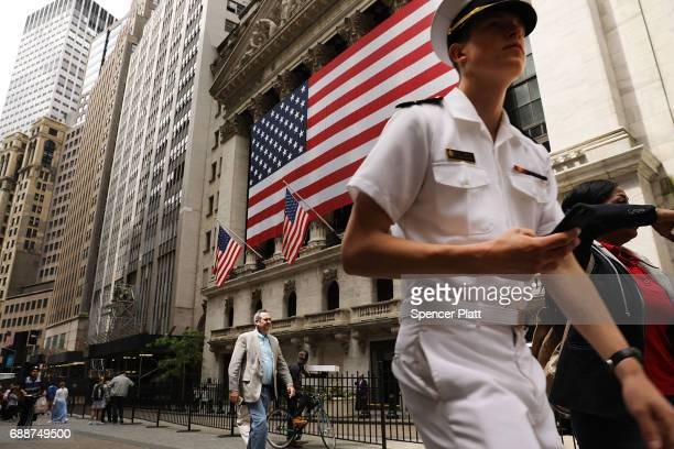 A sailor from the United States Naval Academy walks along Wall Street on May 26 2017 in New York City Now in its 29th year Fleet Week brings more...