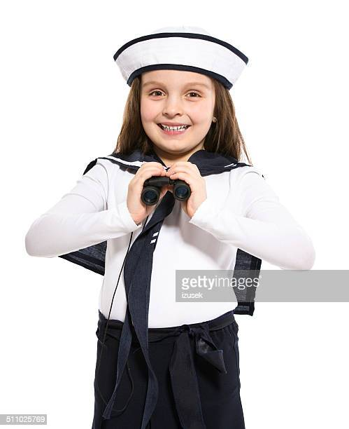 sailor girl with binoculars - sailor hat stock pictures, royalty-free photos & images