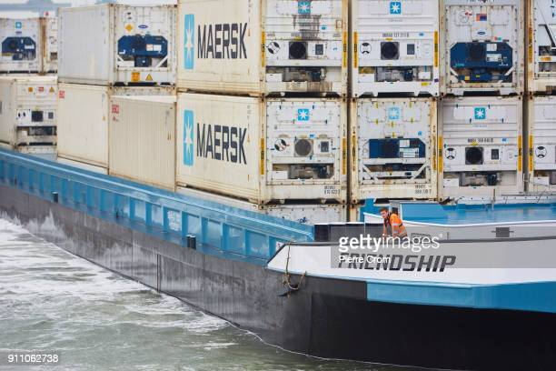 A sailor is maneuvering a ship transporting shipping containers in the Port of Rotterdam the largest port in Europe in Rotterdam on January 27 2018...