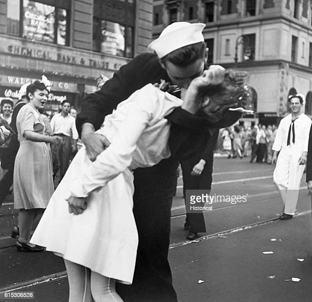A sailor kisses a nurse passionately in Manhattan's Times Square as New York City celebrates the surrender of Japan on August 14 1945 Kissing...